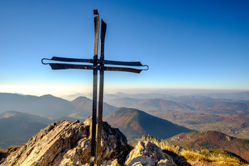 Scenic landscape view of mountain peak with metal cross, Slovaki