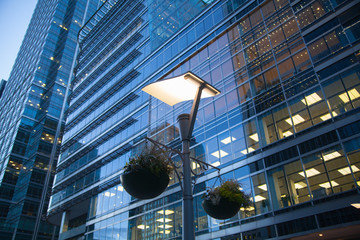 LONDON, UK - May 18, 2015: Banking headqquaters in Canary Wharf. Office building at sunset