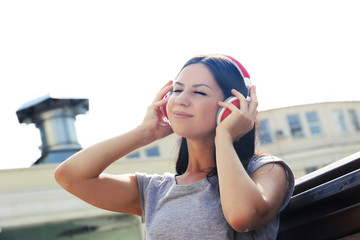 Attractive young woman listen music with headphones