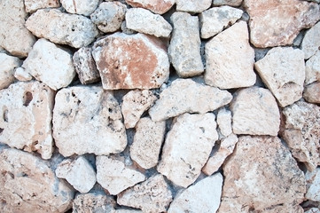 Drystone wall with some cigarette stubs in Mallorca, Balearic islands, Spain.