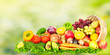 Fruits and vegetables over green background.