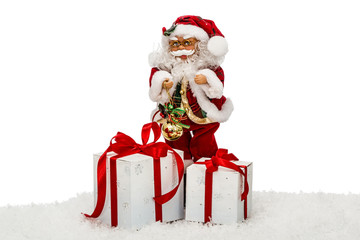 Santa Claus on snow with gift boxes - toy, isolated on white bac