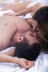 Seductive woman kissing his lover