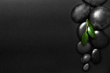 Spa stones on black background