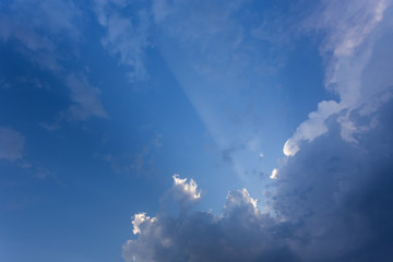 sun beam in blue sky with clouds background