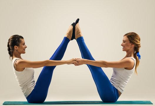 yoga in pair. Buddy boat pose. Balance