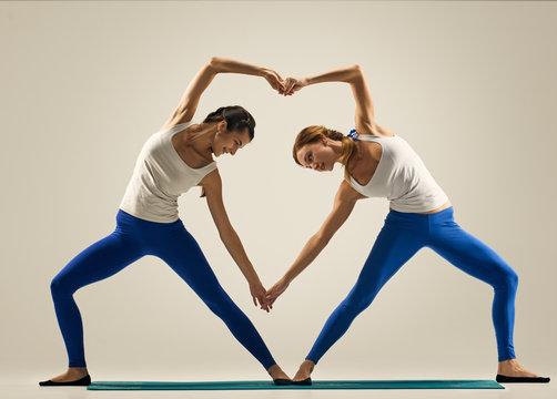 yoga in pair. heart