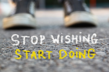 low angle image of asphalt road and person sneakers with the text stop wishing start doing