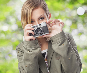 beautiful young woman taking photos with a camera