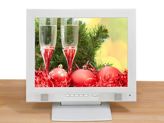 red balls and glasses on screen of gray monitor