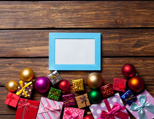 Blue photo frame and christmas gifts