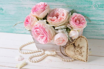 Sweet pink roses in box and decorative heart