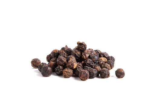 Black pepper on white background