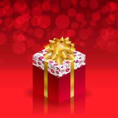 Gift box with gold bow on red background