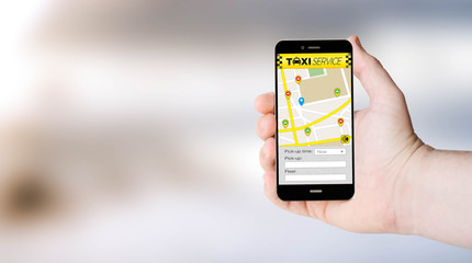 mobile app taxi on user´s hand
