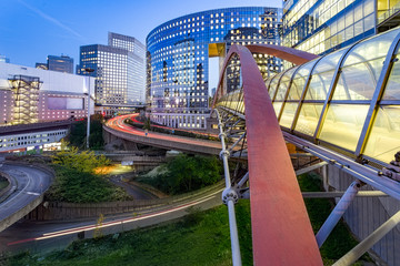Sunset and Illuminated bridge linking two building together at La Defense, the European largest business district located in West of Paris, France