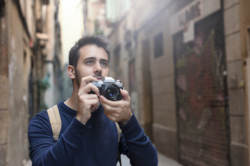 Young man taking photos in Barcelona