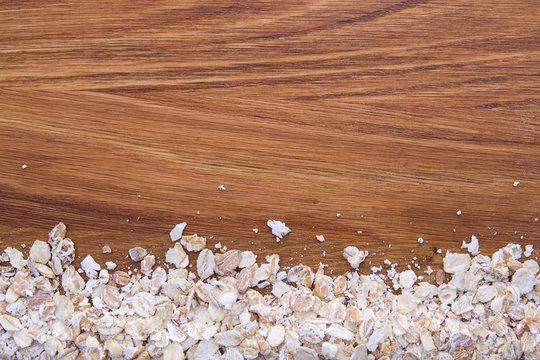 oat flakes on a dark wood