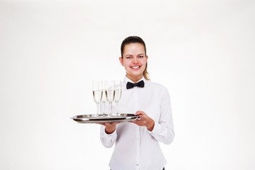 Woman in waiter uniform holding tray and glasses with champagne,