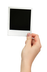 Polaroid photo in hand isolated