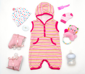 top view of baby girl clothes and toy stuff