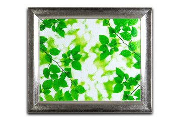 Decorative silver frame isolated on white. Green leaves pattern inside.