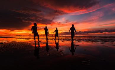 A group of man walking along the coast