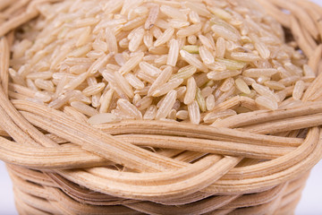 unpeeled rice in a basket closeup