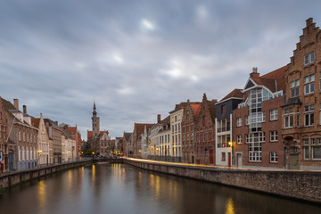 North of the Markt at Briges with church, traditional houses and moving clouds, Bruges, Belgium