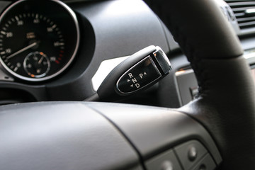 Detail on a automatic gear shifter in a new car.