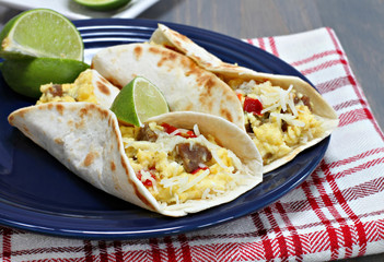 Breakfast tacos with sausage, cheese and peppers