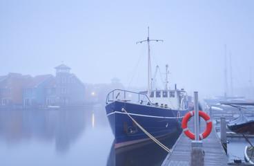 ship on harbor in dense fog