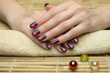 Beautiful woman's nails with nice stylish manicure in the salon