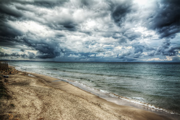 Fotobehang - dramatic sky over the sea