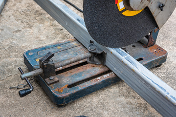 A square metal and steel with compound mitre saw with circular blade