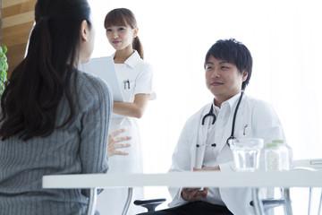 Women undergoing medical examination at a hospital