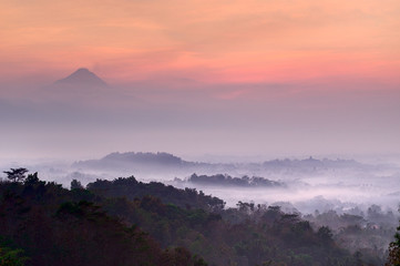 Pre-dawn at Setumbu hill with the view of Borobudur and  Merapi