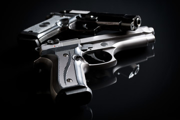 handguns on black background