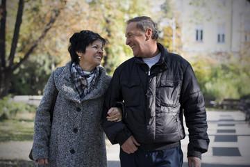 Senior couple enjoying fall in park