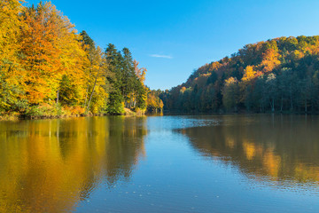 Reflection of trees on Trakoscan lake in Zagorje, Croatia, season, autumn