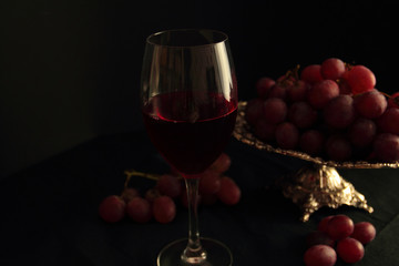 Glass of red wine and fresh grapes