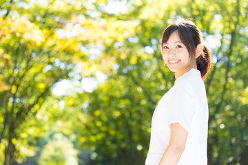 young asian nurse in the park