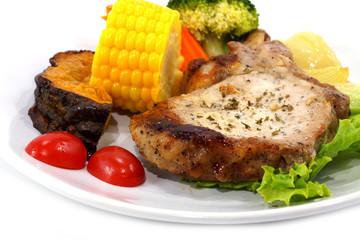 Pork steak and vegetables.