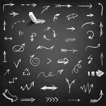 Set of chalk arrows isolated on black background