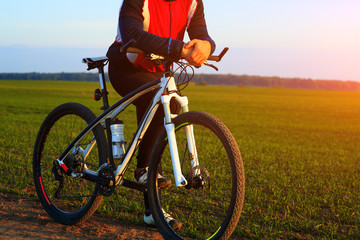 young adult cyclist riding mountain bike in the countryside