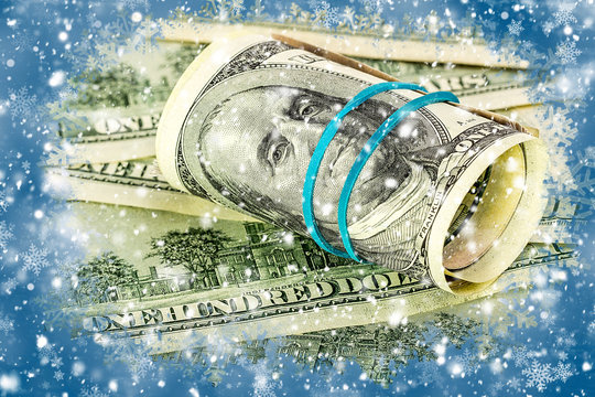 One hundred dollars on a winter background