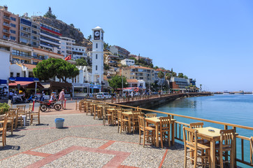 Kusadasi on the Aegean Sea in Turkey - promenade and waterfront. Kusadasi is a major tourist center with modern yacht port Wall mural