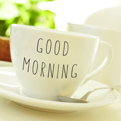 text good morning on a cup of coffee or tea