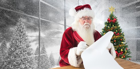 Composite image of santa writes something with a feather