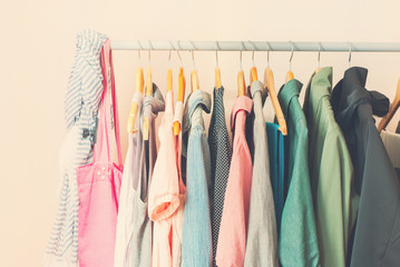 Pastel Color Female Clothes in a Row on Open Hanger. Toned